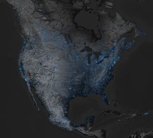 Map of North America at night, noting lighting of transportation networks.