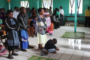 Candid photography of parishioners at Lutheran church service in Papua New Guinea.