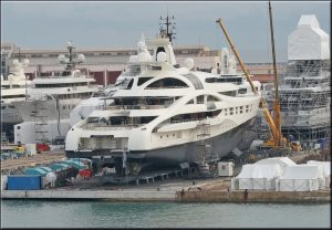 Photo showing immense yacht in dry dock.