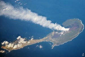 Aerial photography of a steam plume from a volcano on Pagan Island in the Northern Mariana Islands in the Pacific Realm.