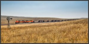 Photograph of a train moving across the Great Plains.