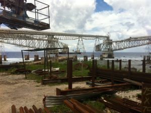 Photography of machinery to loaded phosphate deposits onto ships in Nauru in the Pacific Realm.