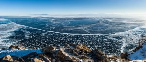 Panoramic photograph of icy Lake Baikal in Siberia.