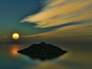 Sunset photo of tiny island in the South Pacific.
