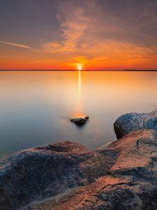 Striking sunset/sunrise photograph lakeside in Madison, Wisconsin.