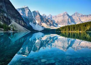 Stunning photograph of Moraine Lake, Banff, Alberta, Canada. Mountain lake scene where the water reflects the peaks.