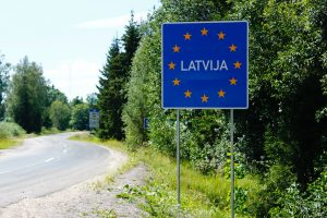 Photograph showing a Latvia sign at the border crossing.