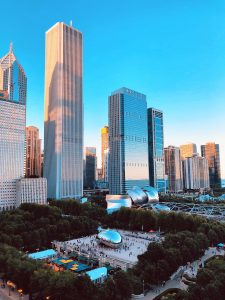 """Photograph of Chicago skyline and park with """"The Bean"""" art."""